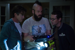 Quinn's father Sean (Dermont Mulroney, left) talks to the ghost hunting duo of Tucker (Angus Sampson) and Specs (Leigh Whannell) about how to save his daughter from The Further. Photo by Matt Kennedy.