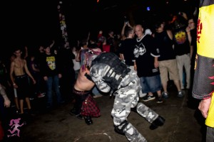 Stryknyn and a riot gear guy keep the pit going. Photo by Get Hashley Photography.