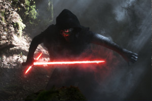 Kylo Ren (Adam Driver), with his unique lightsaber, is one of the more mysterious new characters. Photo by David James.