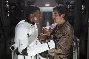 Finn (John Boyega) and Poe Dameron (Oscar Isaac) plot their escape from the First Order. Photo by David James.